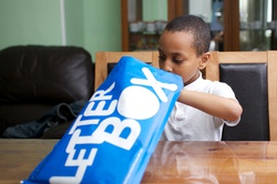 boy-with-blue-parcel